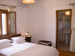 Villa Eleftheria's master bedroom with en-suite shower room