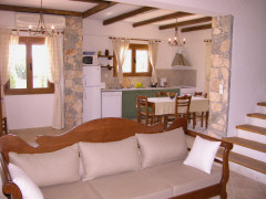 Open-plan lounge and kitchen in Villa Kalithea